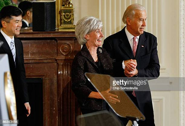 S Vice President Joe Biden grabs the hand of Health and Human Services Secretary Kathleen Sebelius who feigns a look of concern after Biden stumbled...