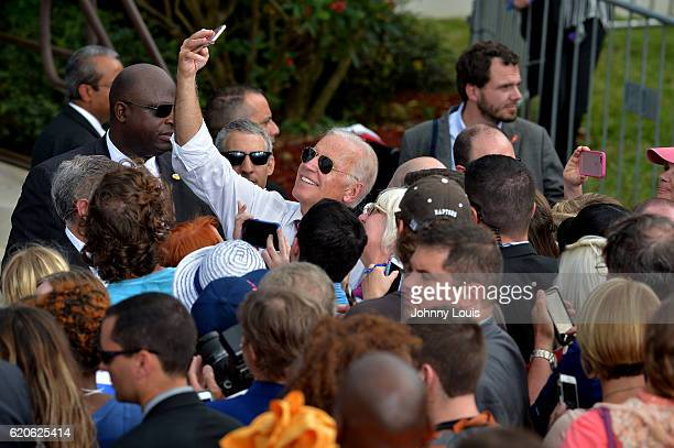 Vice President Joe Biden greet supporters during a public campaign rally for Get Out The Early Vote for Democratic presidential nominee Hillary...