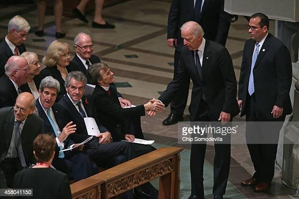 Vice President Joe Biden greets Bishop Mariann Budde as Supreme Court Associate Justice Stephen Breyer Secretary of State John Kerry British...
