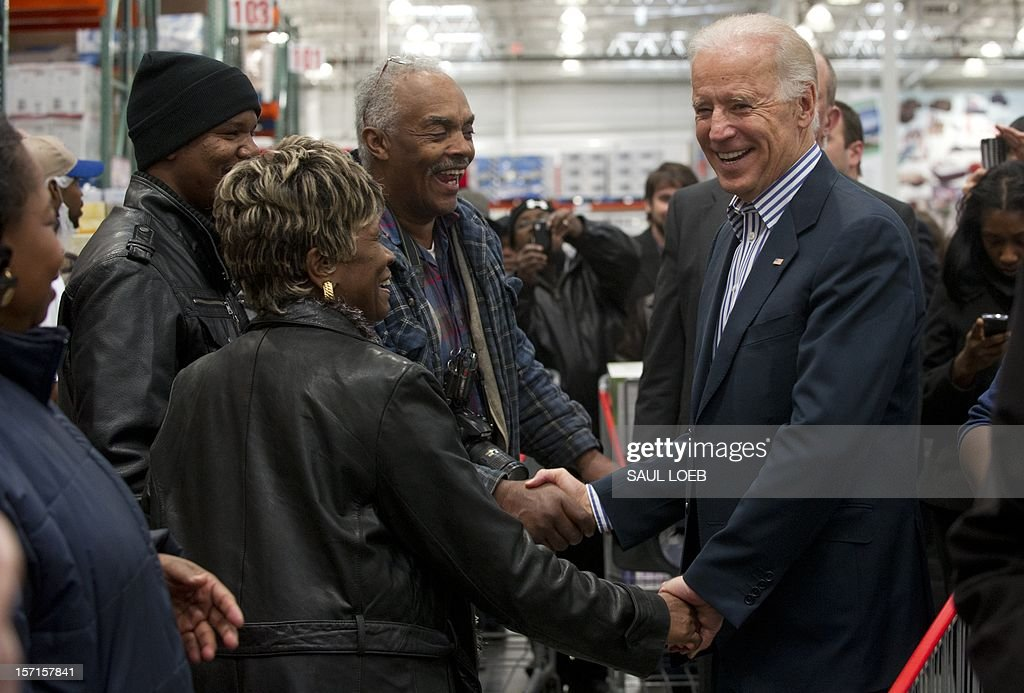 US Vice President Joe Biden greets customers as he shops during a visit to a Costco store in Washington, DC, on November 29, 2012. Biden made the visit to the first Costco store located in Washington, DC, during its grand opening. AFP PHOTO / Saul LOEB