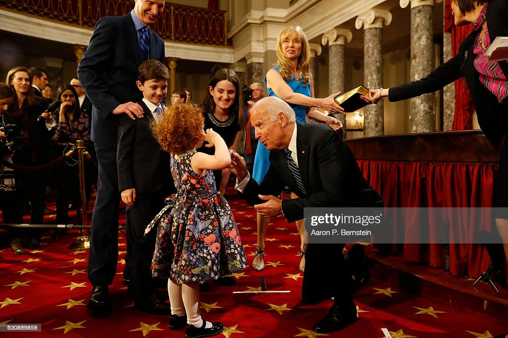 U.S. Vice President Joe Biden greets the children of U.S. Sen. Ron Wyden (D-OR) in the Old Senate Chamber at the U.S. Capitol January 3, 2017 in Washington, DC. Earlier in the day Biden swore in the newly elected and returning members on the Senate floor.