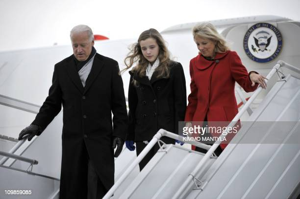 US Vice President Joe Biden his granddaughter Finnegan and his wife Jill arrive at HelsinkiVantaa airport on March 7 2011 Finland is the first stop...