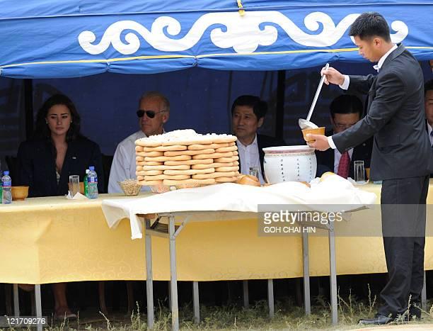 US Vice President Joe Biden his granddaughter Naomi Biden and Mongolian Prime Minister Sukhbaatar Batbold watch a performance of traditional...