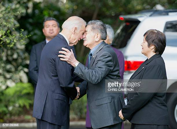 US Vice President Joe Biden is given a traditional Maori greeting by Maori elder Lewis Moeau as elder Hiria Hape looks on during a ceremony at...