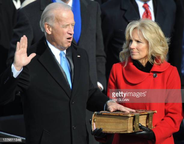 Vice President Joe Biden is sworn in with his wife Jill at the Capitol in Washington on January 20, 2009. AFP PHOTO/Tim SLOAN