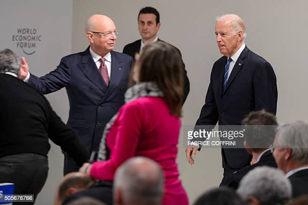 US Vice President Joe Biden is welcomed by founder and executive chairman Klaus Schwab prior to a session 'Cancer Mooshot A Call to action' during...