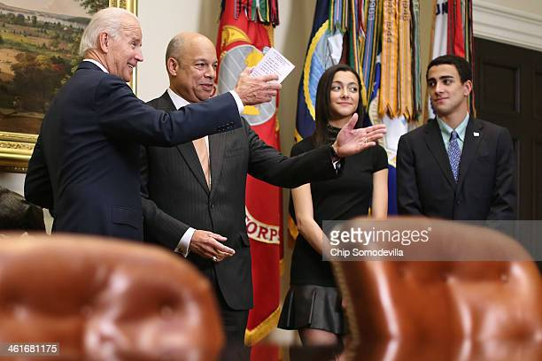 US Vice President Joe Biden jokes with Homeland Security Secretary Jeh Johnson before ceremonally swearing him in with his children Natalie Johnson...
