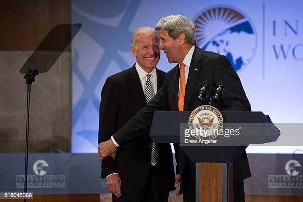 S Vice President Joe Biden laughs as Secretary of State John Kerry introduces him to speak at the 2016 International Women of Courage Forum at the...