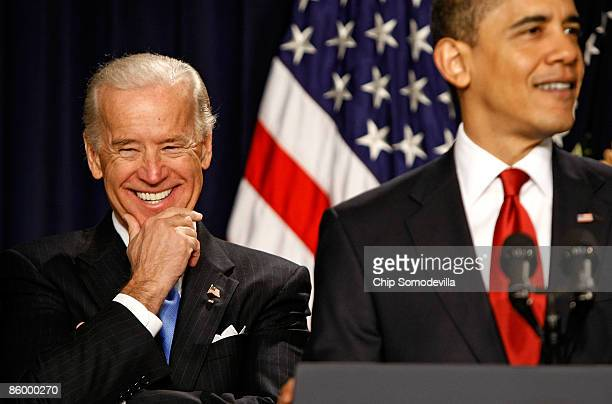 S Vice President Joe Biden laughs at a joke while President Barack Obama delivers remarks on efforts to transform travel in America with a system of...