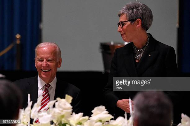 Vice President Joe Biden listens to the Governor of Victoria Linda Dessau give a speech during a dinner at Government House in Melbourne Sunday July...