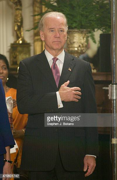 Vice President Joe Biden listens to the national anthem before US President Barack Obama and Indian Prime Minister Manmohan Singh take part in an...