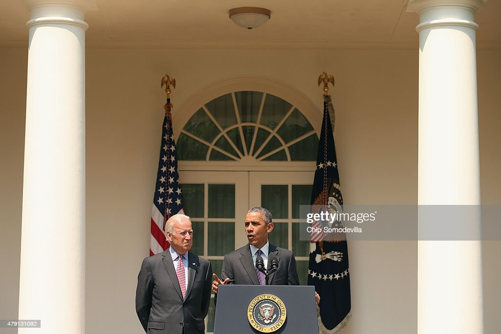 U.S. Vice President Joe Biden looks on as U.S. President Barack Obama speaks at a press conference in the Rose Garden at the White House July 1, 2015 in Washington, DC. Obama announced that Cuba and the United States would re-establish diplomatic ties, including an exchange of ambassadors and embassies.