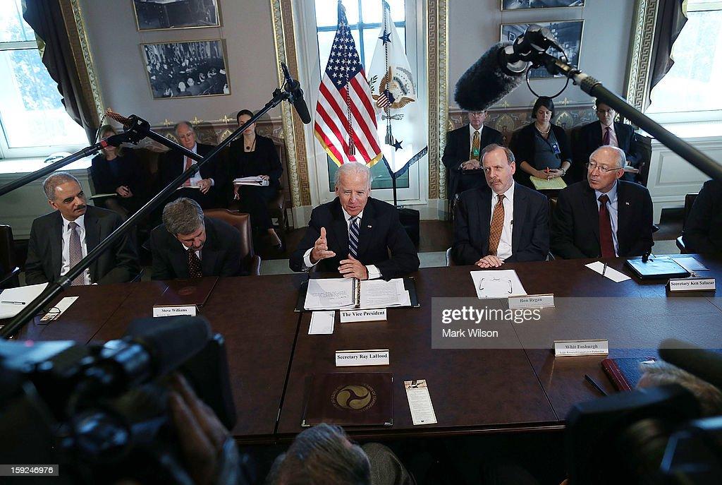 U.S. Vice President Joe Biden (C) makes brief remarks to the press after a meeting with Cabinet members and sportsmen's, wildlife and gun interest groups as Attorney General Eric Holder (L), Steve Williams of the Wildlife Management Institute (2nd L), Ron Regan of the Association of Fish and Wildlife Agencies (2nd R) and U.S. Interior Secretary Ken Salazar listen at the Eisenhower Executive Office Building January 10, 2013 in Washington, DC. U.S. President Barack Obama appointed Biden to oversee a task force on gun violence and also was to meet with a representative of National Rifle Association (NRA) in a second day of meetings.
