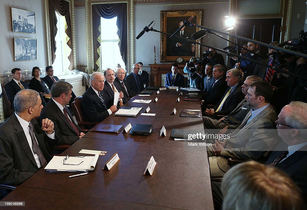 U.S. Vice President Joe Biden (3rd L) makes brief remarks to the press after a meeting with Cabinet members and sportsmen's, wildlife and gun interest groups as Attorney General Eric Holder (L), Steve Williams of the Wildlife Management Institute (2nd L), Ron Regan (4th R) of the Association of Fish and Wildlife Agencies and U.S. Interior Secretary Ken Salazar (3rd R) listen at the Eisenhower Executive Office Building January 10, 2013 in Washington, DC. U.S. President Barack Obama appointed Biden to oversee a task force on gun violence and also was to meet with a representative of National Rifle Association (NRA) in a second day of meetings.