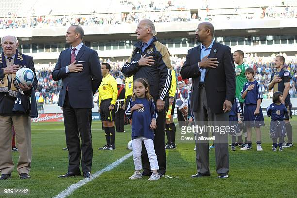 Vice President Joe Biden Mayor Michael Nutter of Philadelphia and Biden's granddaughter Natalie Biden five observe the National Anthem before the...