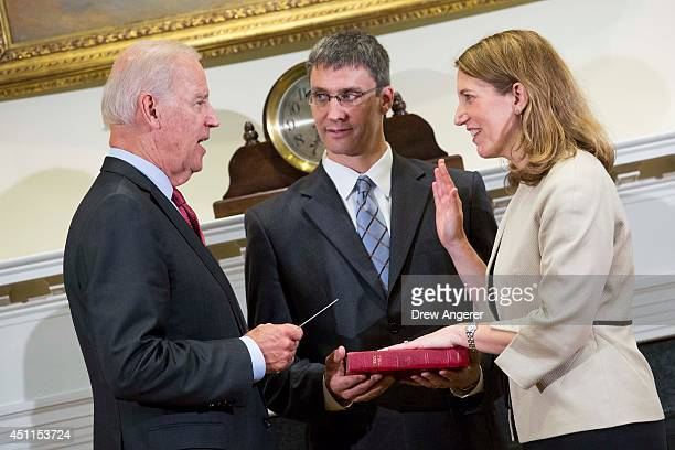 Vice President Joe Biden participates in a ceremonial swearingin event with new Health and Human Services Secretary Sylvia Burwell and her husband...