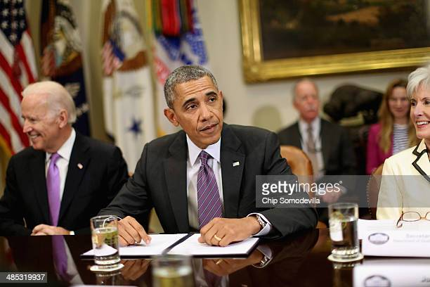 US Vice President Joe Biden President Barack Obama Health and Human Services Secretary Kathleen Sebelius and other administration officials meet with...