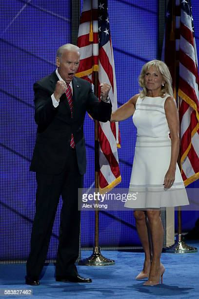 Vice President Joe Biden reacts to the crowd as his wife Jill Biden, looks on after delivering remarks on the third day of the Democratic National...