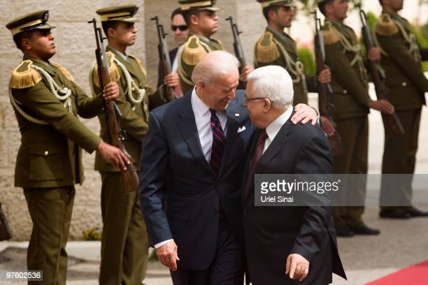 US Vice President Joe Biden reviews a guard of honour alongside Palestinian President Mahmoud Abbas prior to their meeting on March 10 2010 in...