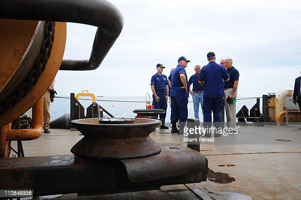 Vice President Joe Biden right speaks with Coast Guard officials aboard a Coast Guard cutter at a US Naval Air Station in Pensacola Florida on...
