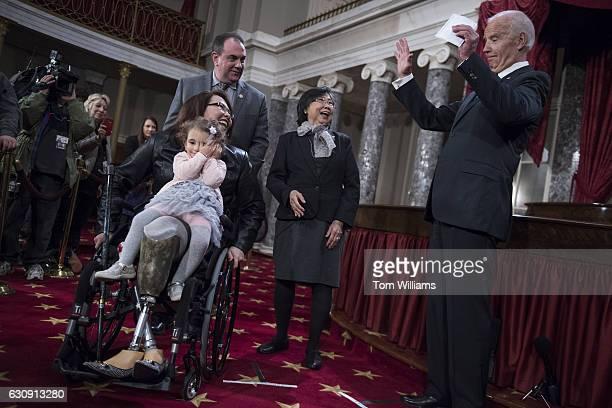 Vice President Joe Biden right talks with Sen Tammy Duckworth DIll her mother Lamai daughter Abigail and husband Bryan Bowlsbey during swearingin...