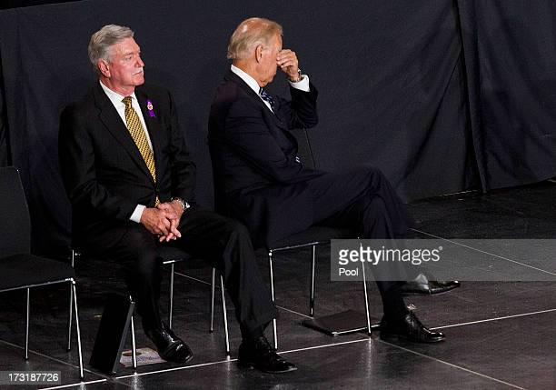 Vice President Joe Biden rubs his eyes during a memorial service honoring 19 fallen firefighters at Tim's Toyota Center July 9 2013 in Prescott...