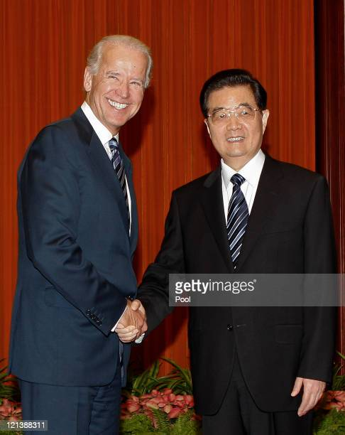 S Vice President Joe Biden shakes hands with China's President Hu Jintao before their meeting at the Great Hall of the People on 19 August 2011 in...