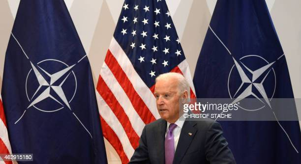 Vice President Joe Biden sits in front of NATO and US flags ahead of a bilateral talk with the NATO Secretary General during the second day of the...