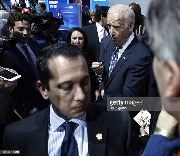 Vice President Joe Biden snacks while touring the 2017 North American International Auto Show on January 10 2017 in Detroit Michigan Approximately...