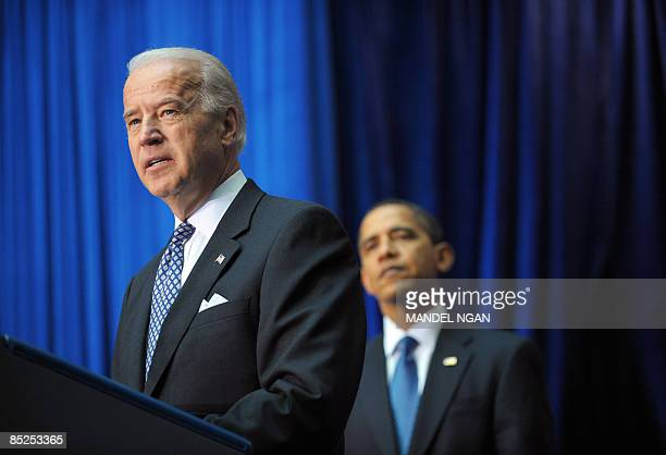 Vice President Joe Biden speaks as US President Barack Obama looks on at the Department of Transportation March 03 2009 in Washington DC Obama spoke...