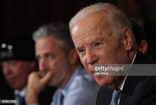 S Vice President Joe Biden speaks during a roundtable on the Cancer Moonshot Initiative as comedian Jon Stewart looks on December 13 2016 at...
