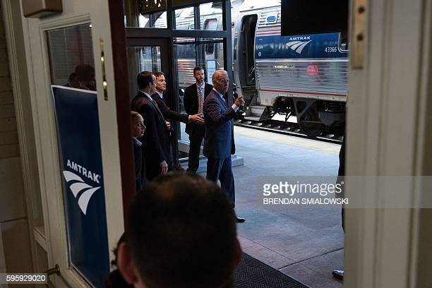 Vice President Joe Biden swalks past a train while leaving after speaking about infrastructure at Amtrak's Joseph R. Biden, Jr., Railroad Station...