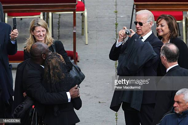 S Vice President Joe Biden takes a photograph of his sister Valerie Biden Owens with a fellow delegate as they leave the Inauguration Mass for Pope...