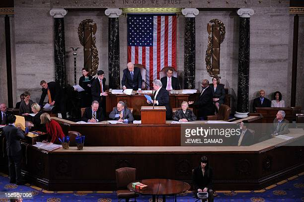 US Vice President Joe Biden takes part in the count of the Electoral College votes for the 2012 presidential election as House Speaker John Boehner...