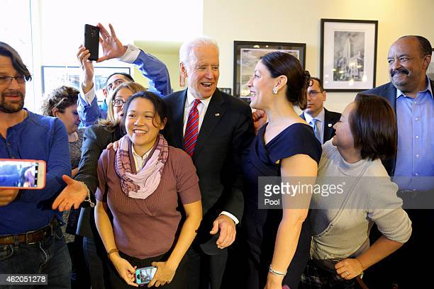 S Vice President Joe Biden takes photos with patrons as he meets with health care officials at the Homegirl Cafe on January 23 2015 in downtown Los...