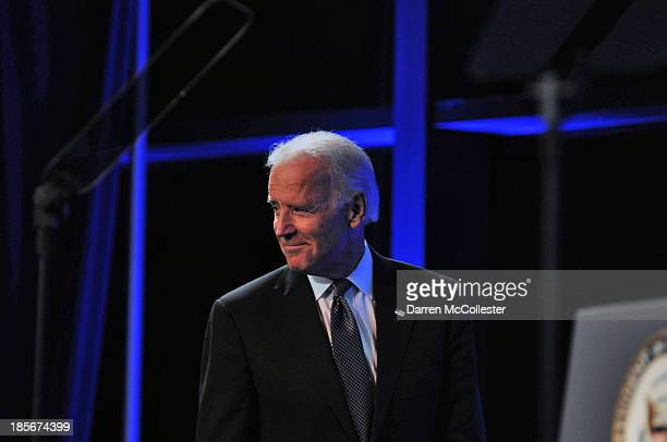 S Vice President Joe Biden takes the stage to speak at a mental health forum at the John F Kennedy Presidential Library and Museum October 23 2013 in...