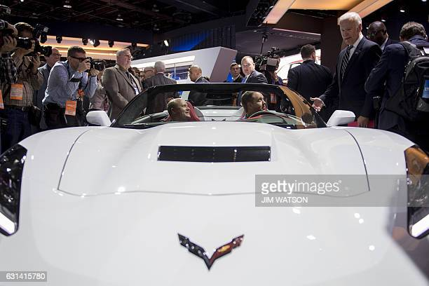 Vice President Joe Biden talks with two men in a Chevrolet Corvette while touring the 2017 North American International Auto Show in Detroit Michigan...