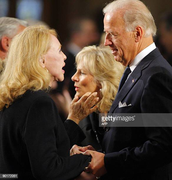 US Vice President Joe Biden talks with US Senator Edward Kennedy's exwife Joan Kennedy as they await the start of the funeral services for US Senator...