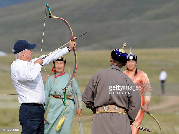 US Vice President Joe Biden tries his hand at archery during a mini Naadam staged in his honour in Ulan Bator on August 22 2011 Biden on August 22...