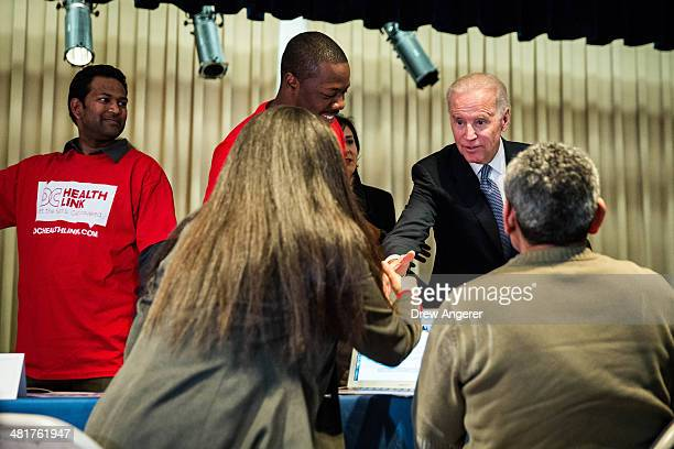 S Vice President Joe Biden visits a sign up site for the Affordable Care Act at the Carlos Rosario International Public Charter School March 31 2014...