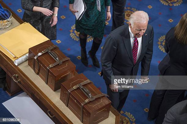 Vice President Joe Biden walks by Electoral College ballot boxes during a joint session of Congress to tally ballots for the president and vice...