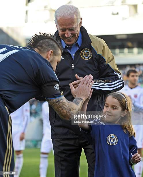 Vice President Joe Biden watches his granddaughter Natalie Biden high five team captain Danny Califf of the Philadelphia Union before the game...