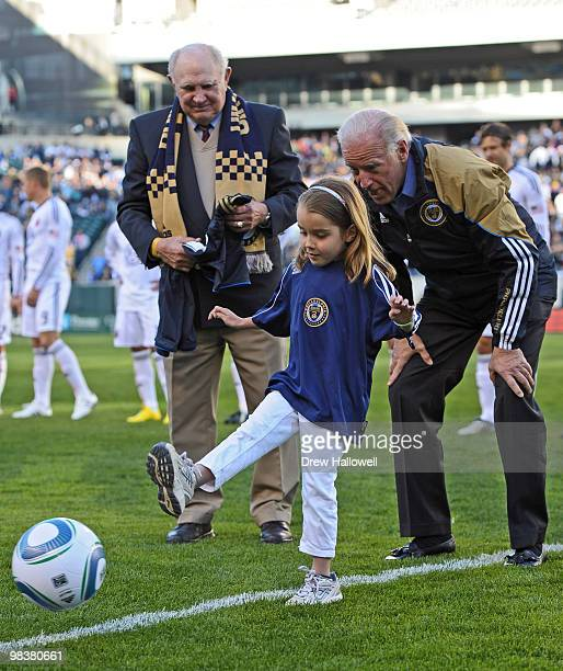 Vice President Joe Biden watches his granddaughter Natalie Biden kick out the first ball before the game between DC United and the Philadelphia Union...