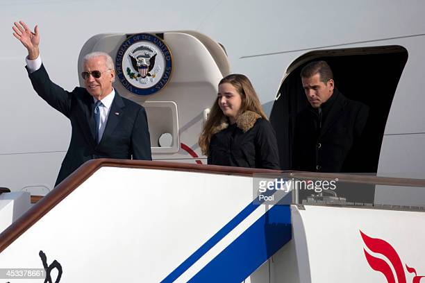 S Vice President Joe Biden waves as he walks out of Air Force Two with his granddaughter Finnegan Biden and son Hunter Biden at the airport December...