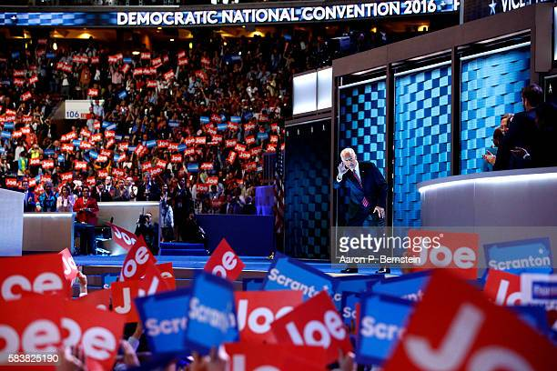 Vice President Joe Biden waves to the crowd as he arrives on stage to deliver remarks on the third day of the Democratic National Convention at the...