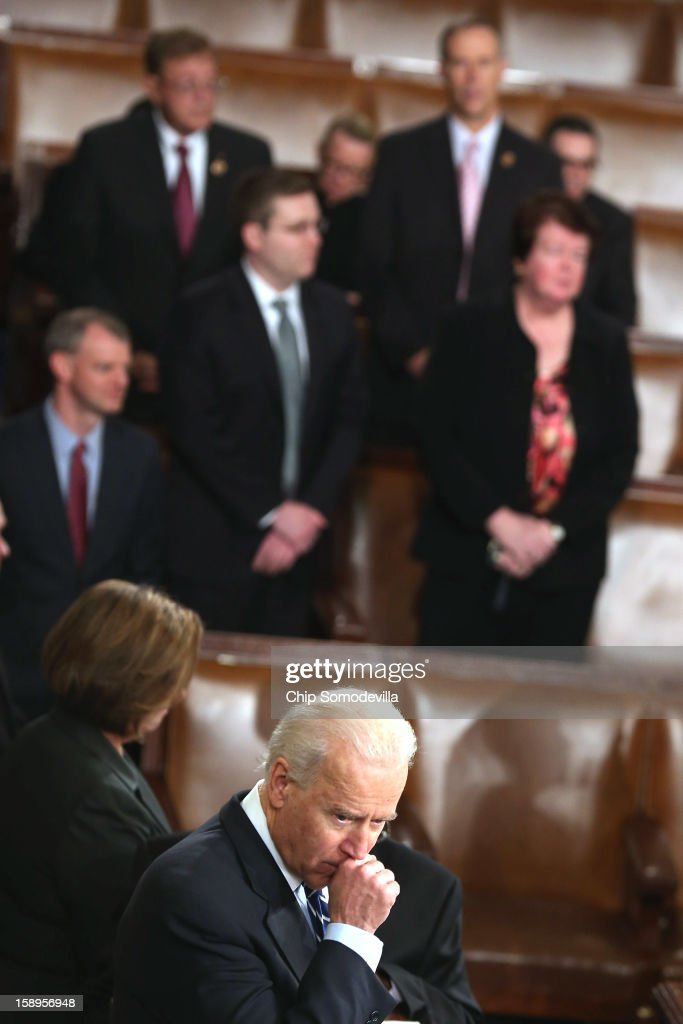 Vice President Joe Biden, who is also the president of the Senate, helps count the Electorial College votes from the 50 states in the House of Representatives chamber at the U.S. Capitol January 4, 2013 in Washington, DC. The votes were tallied during a joint session of the 113th Congress. President Barack Obama and Biden received 332 votes to be reelected.