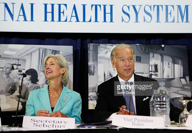 Vice President Joe Biden with Health and Human Services Secretary Kathleen Sebelius listen to health care professionals during a roundtable...