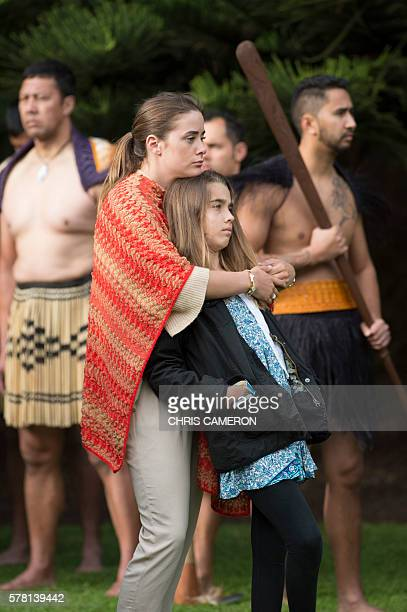 US Vice President Joe Biden's granddaughters 21yearold Naomi Biden and 12yearold Natalie Biden look on as a guard of honour is presented during a...