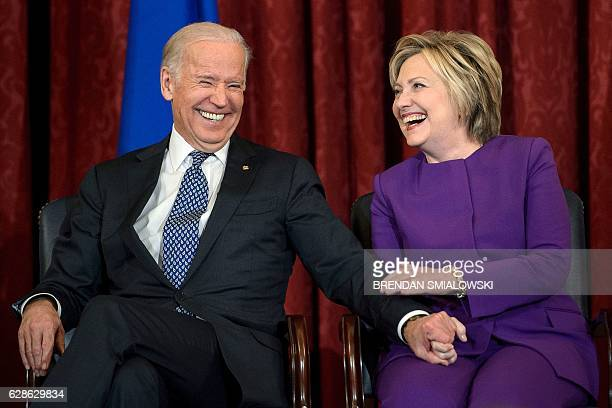 US Vice President Joe R Biden and former Secretary of State Hillary Clinton laugh during a portrait unveiling for outgoing Senate Minority Leader...