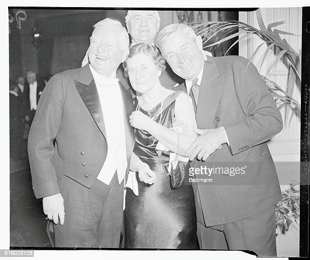 Vice President John N Garner Mrs Garner and will Rogers internationally known humorist are shown in a jovial huddle at the dinner given by Mr and Mrs...